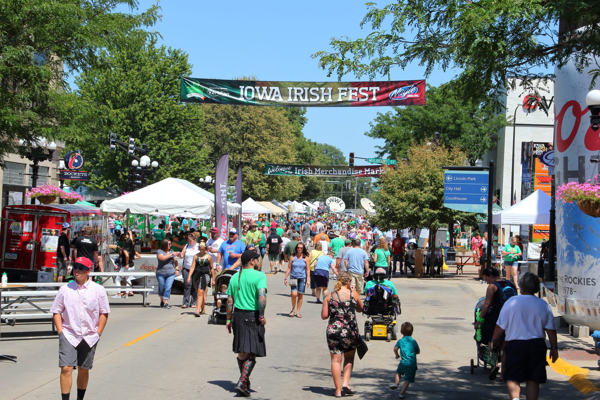 People enjoying Iowa Irish Fest in downtown Waterloo Iowa in the Cedar Valley.