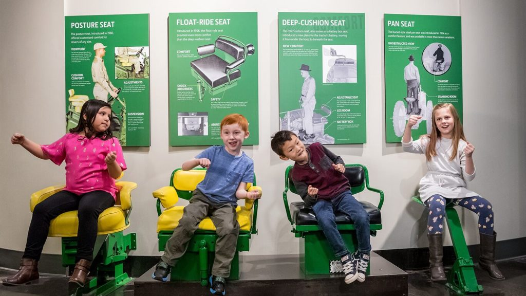 John Deere Museum in Waterloo and the Cedar Valley ranked best museum in Iowa and shows picture of kids playing.